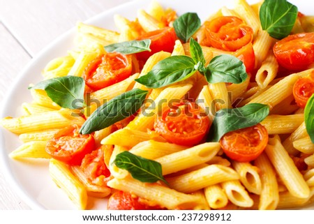 Pasta with fresh tomatoes and basil - stock photo