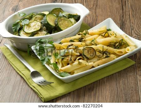 pasta with fresh zucchini and parsley - stock photo