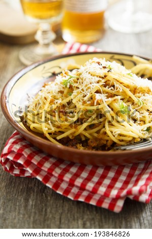 Pasta with garlic bread crumbs and tomatoes - stock photo