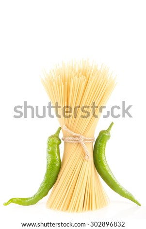Pasta with green hot chilly pepper - stock photo