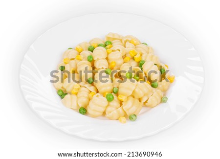 Pasta with green peas and corn. Whole background.
