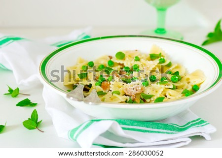 pasta with green peas and creamy sauce. style vintage. selective focus.