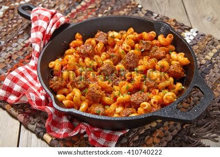 Pasta with italian sausage and tomato sauce - stock photo