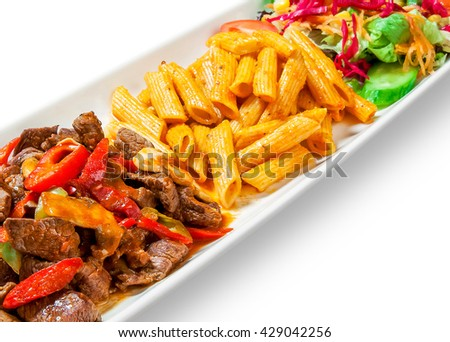 pasta with meat, peppers and vegetables drizzled with sauce in plate on white background - stock photo