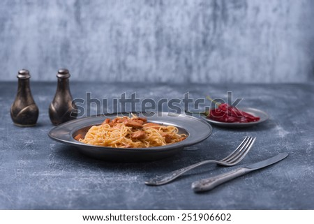 pasta with meat rustic style on old wood table - stock photo