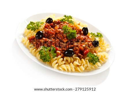 Pasta with meat, tomato sauce and vegetables on white background  - stock photo