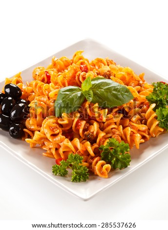Pasta with meat, tomato sauce and vegetables on white background ( shallow DOF )