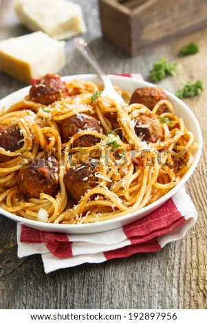 Pasta with meatballs and parmesan cheese - stock photo
