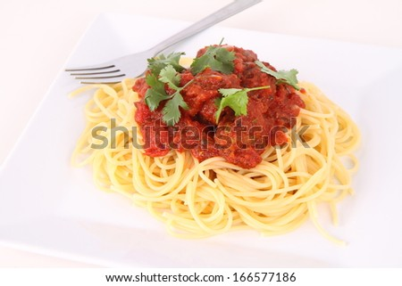 Pasta with meatballs decorated with coriander - stock photo