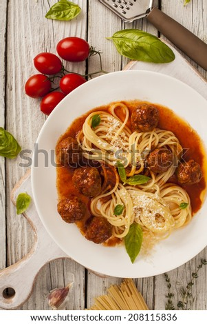 Pasta with meatballs with fresh basil and tomato sauce - stock photo