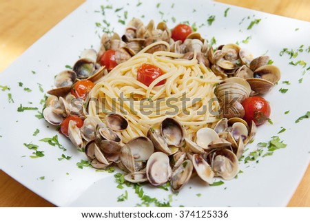 pasta with mussels on a dish close up - stock photo