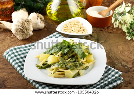 Pasta with pesto, green beans and potatoes on complex background