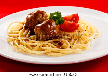 Pasta with roasted meat and vegetables - stock photo