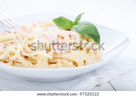 Pasta with salmon - stock photo