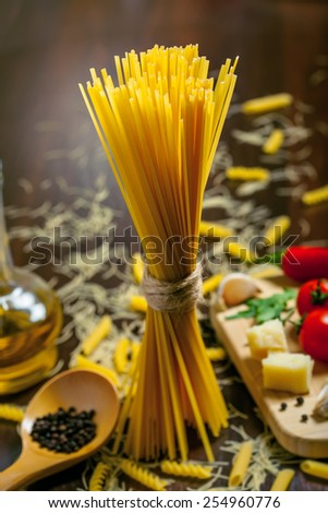 Pasta with sauce ingredients, uncooked food - stock photo