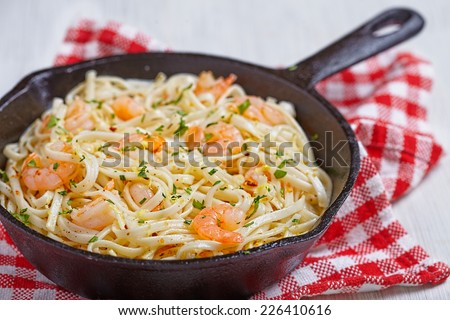 Pasta with Shrimp Scampi in a pan - stock photo