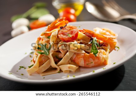 Pasta with Shrimps and Tomato Sauce - stock photo