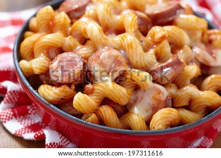pasta with smoked sausage and cheesy tomato sauce - stock photo