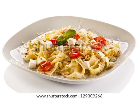 Pasta with tomato and white cheese - stock photo