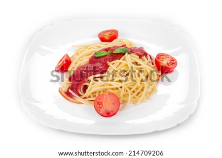 Pasta with tomato sauce and basil. Isolated on a white background.