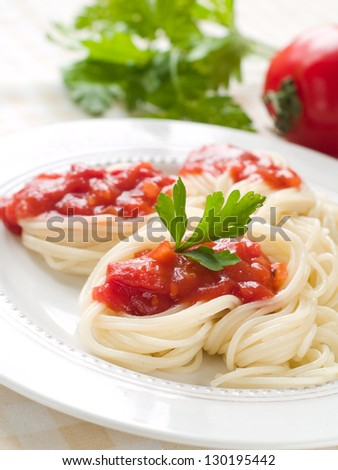 Pasta with tomato sauce and parsley, selective focus