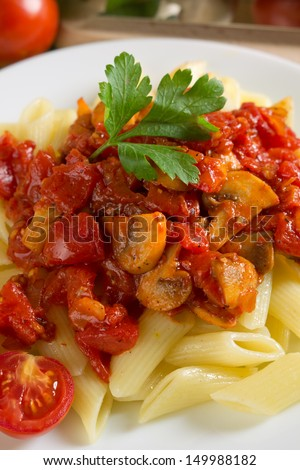 Pasta with tomatoes and mushrooms - stock photo