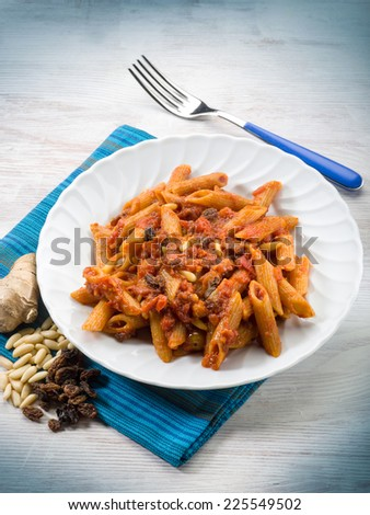 pasta with tomatoes dried grape and pine nuts