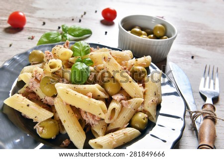 Pasta with tuna chunks and green olives - stock photo