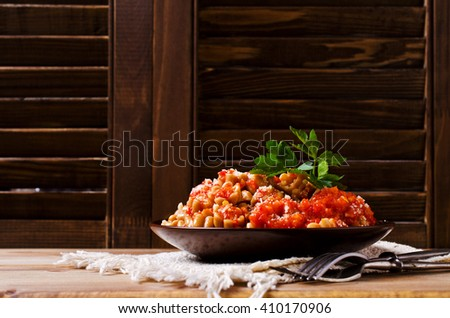 Pasta with vegetable sauce on wooden background. Selective focus. - stock photo