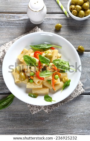 Pasta with vegetables and spinach, food - stock photo