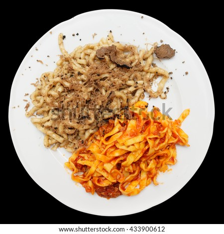 Pastas with black truffle and tomato sauce isolated on black background - stock photo