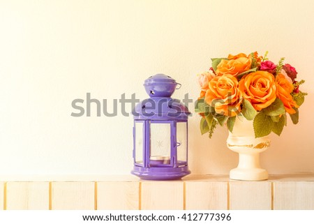 Pastel Artificial Pink Rose Wedding Bridal Bouquet in flower pot  and lamp on white background with grunge and vintage tone. - stock photo