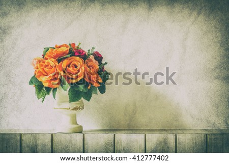 Pastel Artificial Pink Rose Wedding Bridal Bouquet in flower pot on white wooden background with grunge and vintage tone. - stock photo