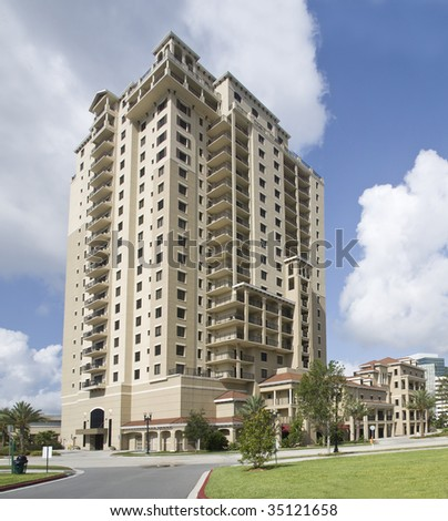 pastel beige luxury condos with tropical landscaping in Jacksonville, Florida - stock photo