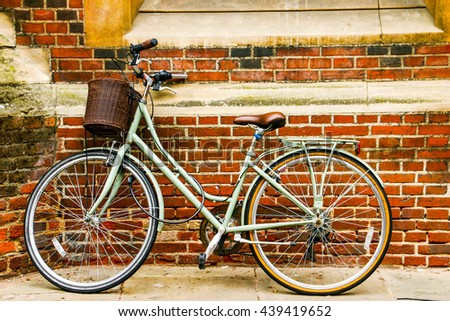 Pastel blue Vintage style bicycle close with red brick wall background