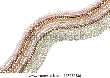 Pastel colored bead and pearls on a white background - stock photo