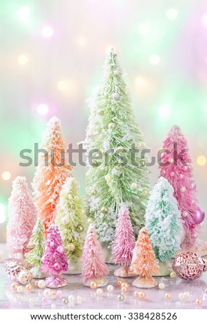 Pastel colored christmas trees and decoration - stock photo