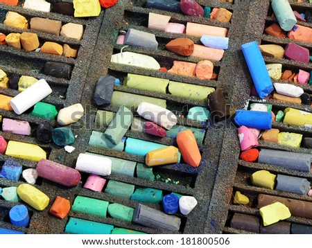 pastel colored crayons in a box, horizontal          - stock photo