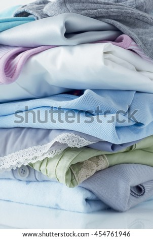 Pastel colored pile of clothing  - stock photo
