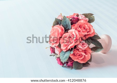 Pastel Coloured Artificial Pink Rose Wedding Bridal Bouquet, Vintage style. - stock photo