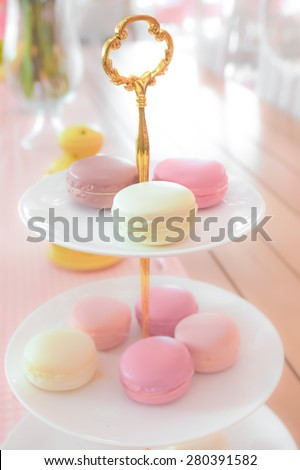 Pastel Macarons on Serving Rack in Blur Style, for Background, Dreamy Effect. - stock photo