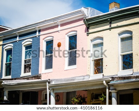 Pastel painted row homes in Hampden, a popular neighborhood in Baltimore Maryland. - stock photo