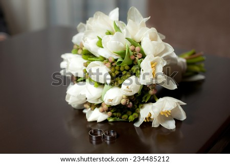 Pastel wedding bouquet with tulips on wood