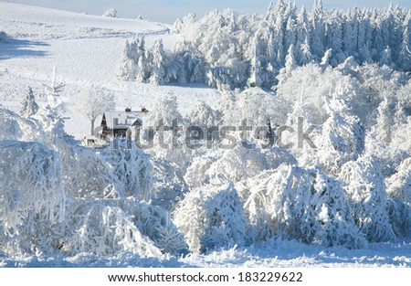Pasterka village in Stolowe Mountains in Poland by snowy winter. - stock photo