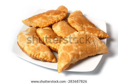 Pasties on white plate with white background - stock photo