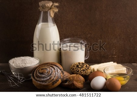 Pastries and its ingredients against a dark background.