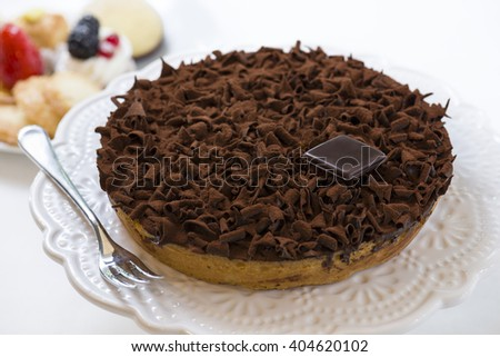 pastry cake, covered with chocolate flakes and cocoa  - stock photo