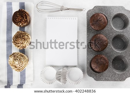 Pastry cakes : chocolate muffins with cream. Space for text - stock photo