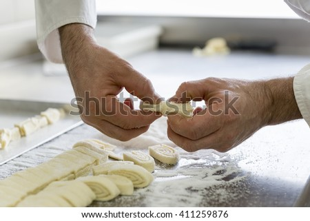 pastry chef shapes the dough with your hands for cookies