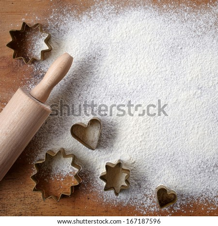 pastry cutters on wooden cutting board - stock photo